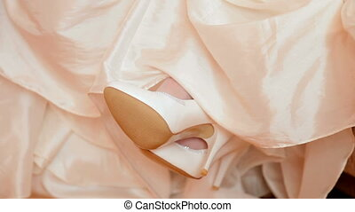 white wedding shoes against white embroidered dress