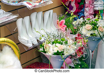 White wedding shoes in a weddingstore