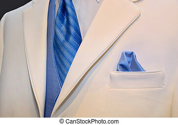 White wedding tuxedo - Blue tie and vest accenting a white...