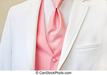 white wedding tuxedo with pink tie