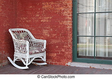 white wicker chair on red brick