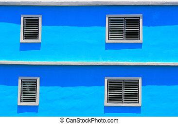 white window on a blue wall