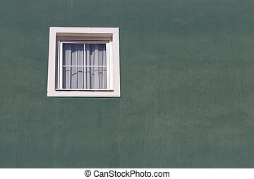 White window on an old green stucco wall as background