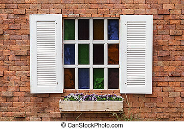 white window on the red brick wall