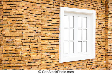 white window on the stone wall