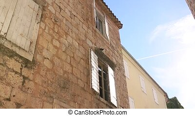 White window shutters. The facade houses in Montenegro