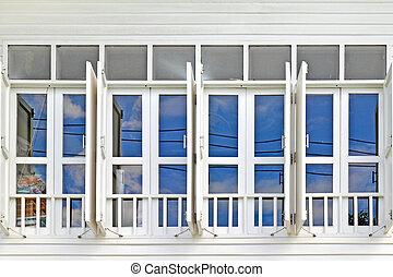 white window with blue sky