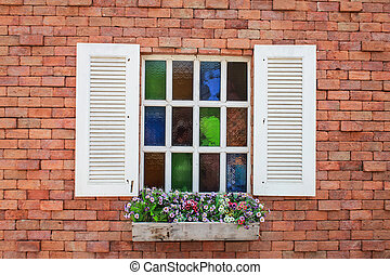white window with brick wall background