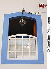 White Window With Pale Blue Trim