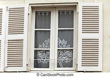 White window with shutters