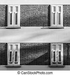 White windows on a building made from bricks