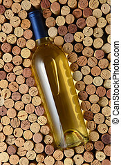 A bottle of Sauvignon Blanc surrounded by corks standing on...