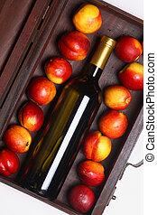 White wine and peaches