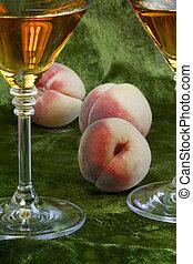 White wine and ripe peaches
