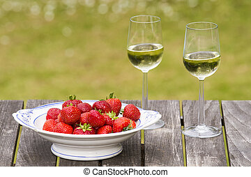 White wine and strawberrys