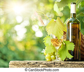 White wine bottle, vine, glass and bunch of grapes - White...