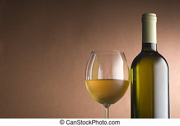 White wine - Bottle with white wine and glass close up