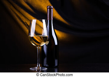 White wine - Glass and bottle of white wine with a dark ...