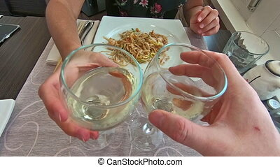 white wine glasses cheers - SLOW MOTION: two white wine...