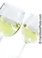 white wine glasses in front of white background