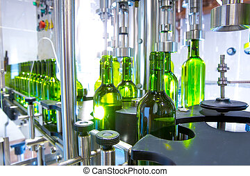 white wine in bottling machine at winery - white wine in...