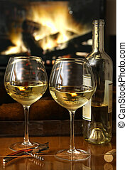 White wine in front of a warm fire
