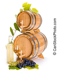 White wine in front of stacked barrels