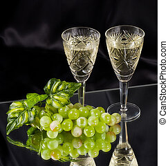 White wine in glass with grape