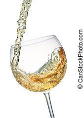 White wine splashing in a glass