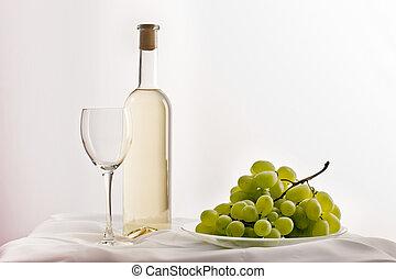 White wine - still life, empty bocal, bottle of white wine...