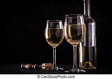 White wine still life in vintage style on black background