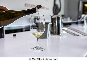 white wine tasting, bottle pouring