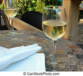 White Wine - Two glasses of white wine on the patio before...