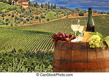 White wine with barrel on vineyard in Chianti, Tuscany, ...