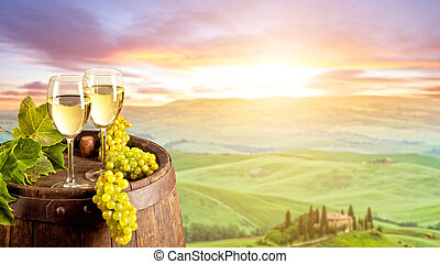 White wine with barrel on vineyard in Italy