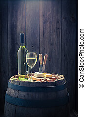 White wine with camembert cheese to snack
