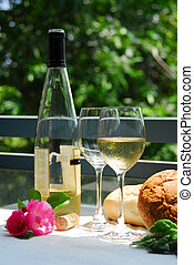 White wine with glasses outside - Table setting with chilled...