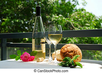 White wine with glasses - Table setting with chilled white...