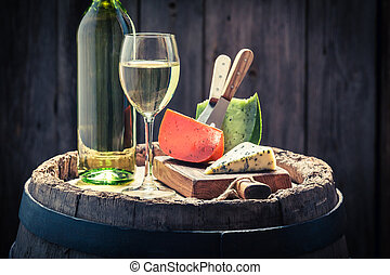 White wine with mix of cheese on odl barrel