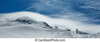 White winter mountains covered with snow in blue cloudy sky. Alps. Austria. Pitztaler Gletscher