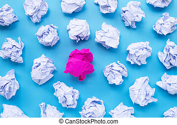 White with pink crumpled paper balls on a blue background.