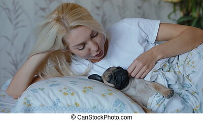 White woman pet the puppy pug