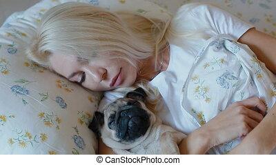 White woman pet the puppy pug