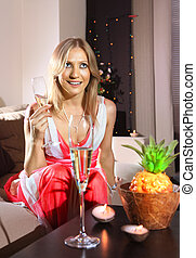 white woman with glass of champagne