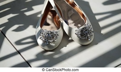 White woman's bridal shoes at balcony