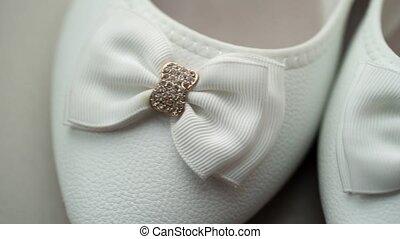 White womans shoes pan closeup