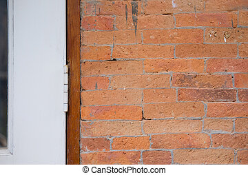 White wood door with red clay brick
