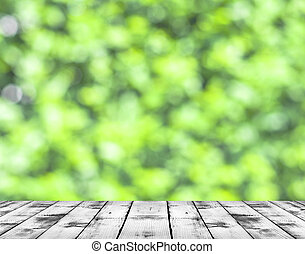 White wood floor and spring green bokeh background