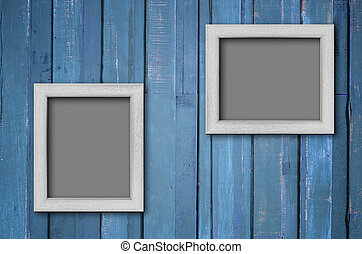 White wood picture frame on Blue wall