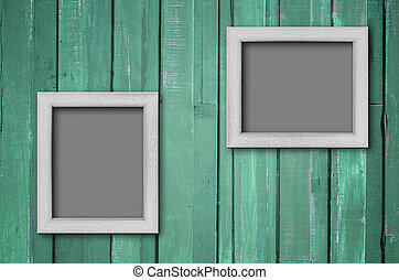 White wood picture frame on Green wall